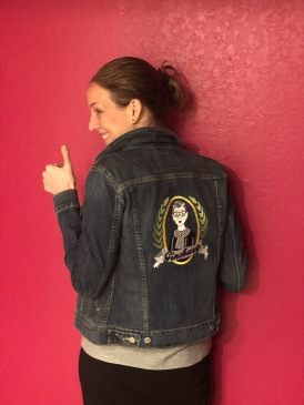 Amy wearing a jean jacket with Ruth Bader Ginsburg emroidered on the back