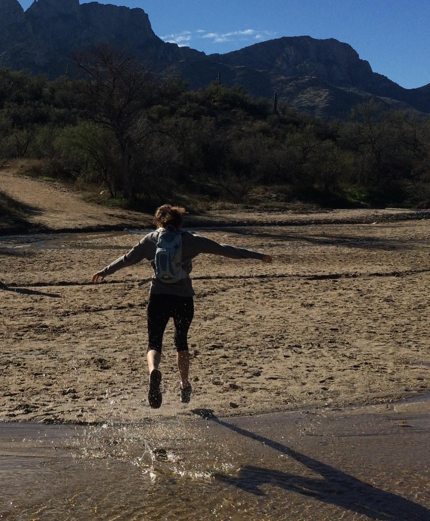 Zabs jumping across a creek